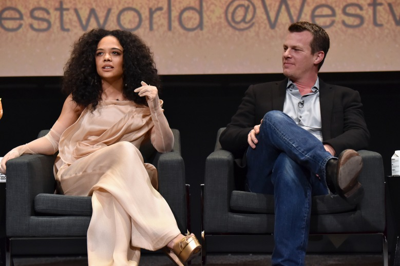 """NORTH HOLLYWOOD, CALIFORNIA - MARCH 06: (L-R) Tessa Thompson and Jonathan Nolan speak onstage during the screening & panel discussion of the HBO drama series """"Westworld"""" at Wolf Theatre on March 06, 2020 in North Hollywood, California. (Photo by Jeff Kravitz/FilmMagic for HBO)"""