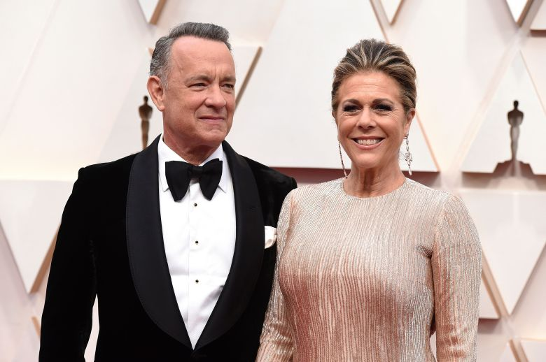 """Tom Hanks, left, and Rita Wilson arrive at the Oscars at the Dolby Theatre in Los Angeles. The couple have tested positive for the coronavirus, the actor said in a statement Wednesday, March 11. The 63-year-old actor said they will be """"tested, observed and isolated for as long as public health and safety requiresVirus Outbreak Tom Hanks, Los Angeles, United States - 09 Feb 2020"""