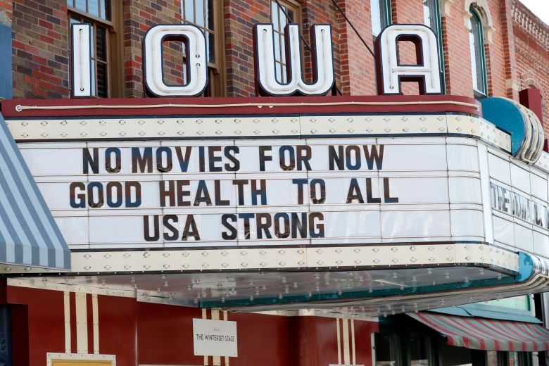 The marquee for the Iowa Theater, closed in response to the coronavirus outbreak, is seen on John Wayne Drive, in Winterset, Iowa. The new coronavirus causes mild or moderate symptoms for most people, but for some, especially older adults and people with existing health problems, it can cause more severe illness or deathUS Virus Outbreak Iowa Daily Life, Winterset, United States - 01 Apr 2020