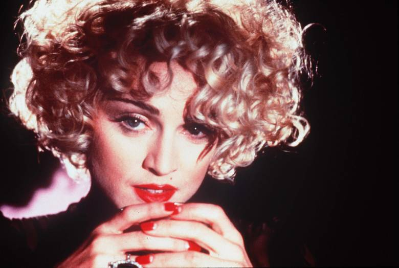 Editorial use only. No book cover usage.Mandatory Credit: Photo by Touchstone/Kobal/Shutterstock (5883075m) Madonna Dick Tracy - 1990 Director: Warren Beatty Touchstone USA Scene Still Action/Adventure