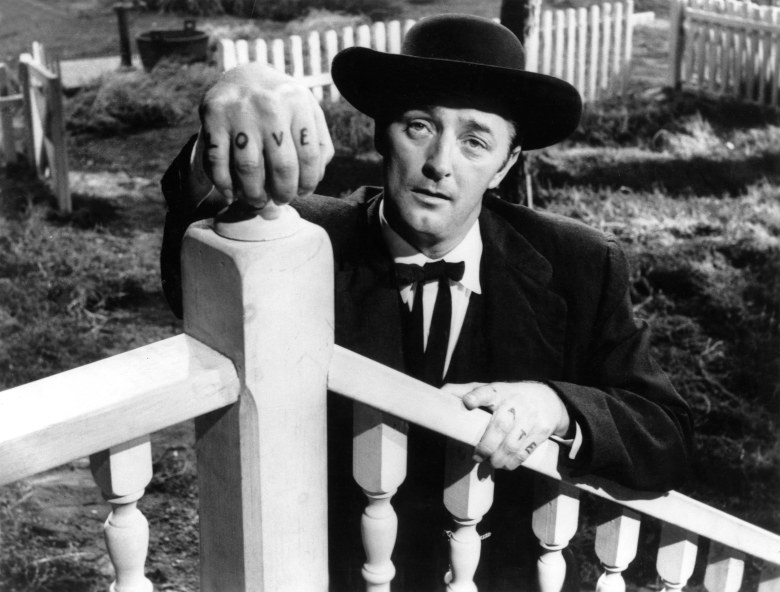 Editorial use only. No book cover usage.Mandatory Credit: Photo by United Artists/Kobal/Shutterstock (5884016w)Robert MitchumThe Night Of The Hunter - 1955Director: Charles LaughtonUnited ArtistsUSAScene StillMystery/SuspenseLa Nuit du chasseur
