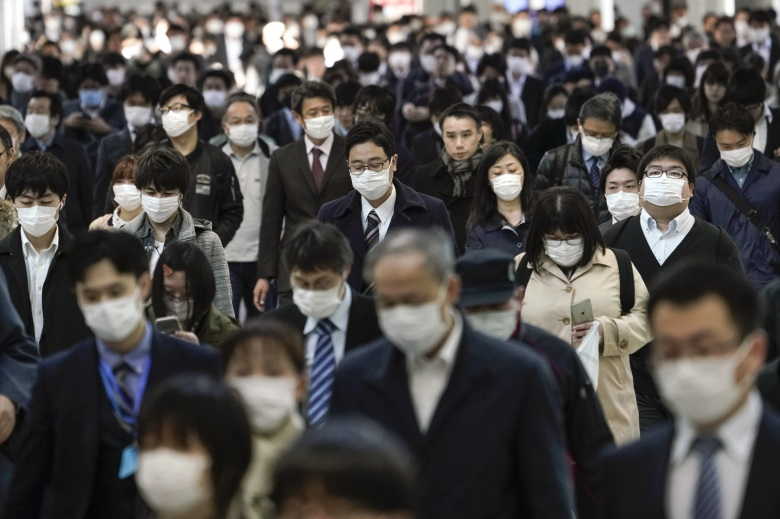 Office workers wearing protective masks to avoid infection from the coronavirus walk to their offices after taking overcrowded commuter trains, at a railway station in central Tokyo, Japan, 06 April 2020. Japanese Prime Minister Shinzo Abe is expected to declare the state of emergency on 07 April 2020 over the COVID-19 and coronavirus outbreak.Office workers commute to their offices during coronavirus pandemic, Tokyo, Japan - 06 Apr 2020