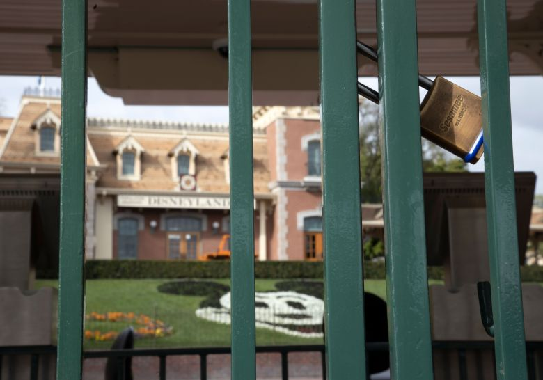 An entrance gate to the Disneyland theme park is locked after the park was closed to help prevent the spread of the coronavirus, in Anaheim, California, USA, 14 March 2020. The park will remain closed at least until the end of March 2020.Disneyland Resort in California closes amid coronavirus pandemic, Anaheim, USA - 14 Mar 2020