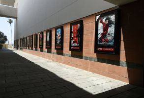 Posters for upcoming movies are displayed in an empty corridor at the currently closed AMC Burbank Town Center 8 movie theaters complex, in Burbank, CalifFilm Theatrical Window Cracks, Burbank, United States - 29 Apr 2020