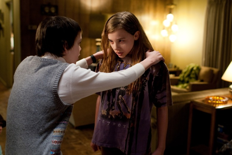 Editorial use only. No book cover usage.Mandatory Credit: Photo by Hammer Film Productions/Kobal/Shutterstock (5885681ah) Kodi Smit-McPhee, Chloe Moretz Let Me In - 2010 Director: Matt Reeves Hammer Film Productions USA/UK Scene Still Laisse-moi entrer