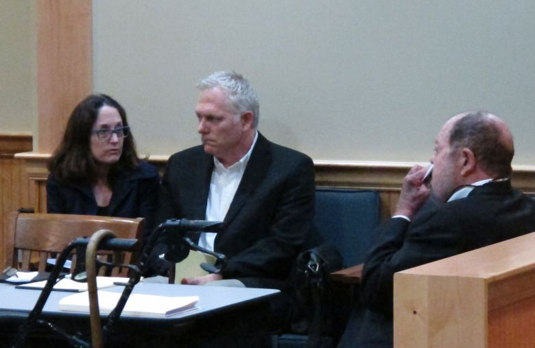 """Film director Randall Miller, center, sits in a Georgia courtroom with his wife, Jody Savin before pleading guilty to charges of involuntary manslaughter and criminal trespassing . Miller was filming """"Midnight Rider,"""" a biographical movie about singer Gregg Allman, when a freight train plowed into his crew on a railroad bridge last year. Camera assistant Sarah Jones was killed and six others were injuredFilm Crew-Train Crash, Jesup, USA"""