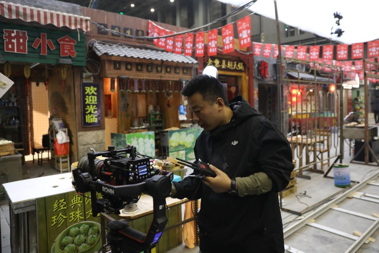 A member of a film crew works in a 10,000-square-meter film studio pavilion of Wanda Oriental Movie Metropolis in Qingdao, Shandong province, China, 28 April 2018. Wanda Qingdao Oriental Movie Metropolis opens on 28 April, a major Chinese studio, combining film and television production and several other facilities, funded by Wang Jianlin, CEO of the Dalian Wanda Group. The construction of the facility started on 22 September 2013, with the total investment of 50 billion RMB yuan (around 6.5 billion Euros), it has the world's largest studio pavilion of 10,000 square meters, featuring some of the world's largest and most technologically-advanced facilities.Qingdao Oriental Movie Metropolis, China - 28 Apr 2018