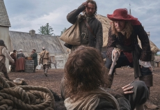 Trepagny (David Thewlis) taps Duquet (James Bloor) with his walking stick as Sel (Christian Cooke) looks on. (National Geographic/Peter H. Stranks)