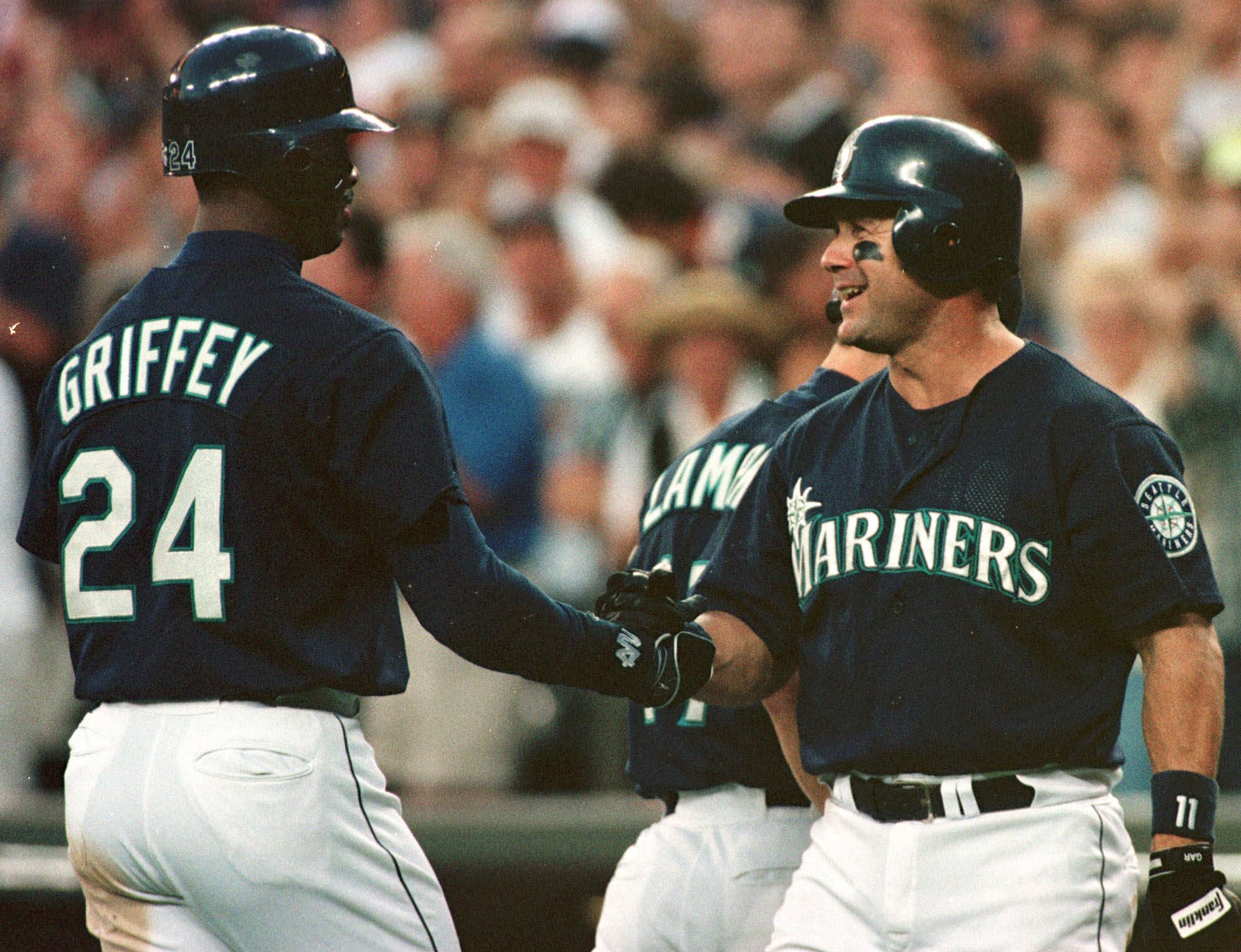 GRIFFEY MARTINEZ Seattle Mariners' Ken Griffey Jr. is congratulated by Edgar Martinez after hitting a two-run homer in the 8th inning against the Cleveland Indians in Seattle . The Indians won 7-4 in 10 innings INDIANS MARINERS, SEATTLE, USA