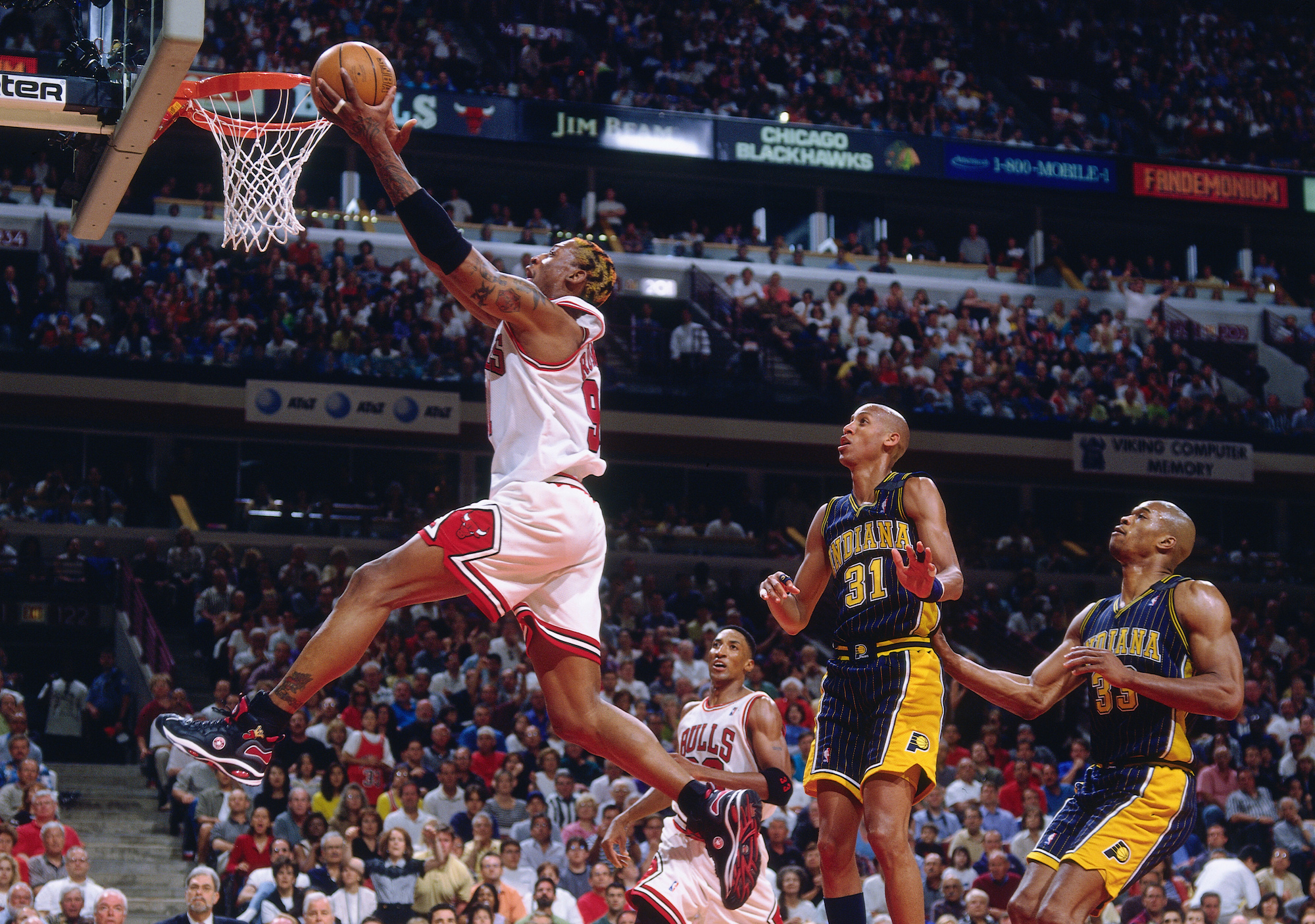 CHICAGO - MAY 17: Dennis Rodman #91 of the Chicago Bulls shoots a layup during a game played on May 17, 1998 at the United Center in Chicago, Illinois. NOTE TO USER: User expressly acknowledges and agrees that, by downloading and or using this photograph, User is consenting to the terms and conditions of the Getty Images License Agreement. Mandatory Copyright Notice: Copyright 1998 NBAE (Photo by Nathaniel S. Butler/NBAE via Getty Images)