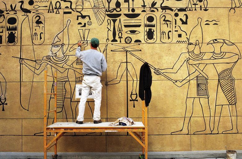 David Martin David Martin works on a drawing outside Grauman?s Egyptian Theater in Hollywood, Los Angeles, . The historic theatre, built in 1922 and known as the theatre ?where the stars see the movies,? will celebrate its grand re-opening on Friday at nightGrauman?s Egyptian Theater, Los Angeles, USA