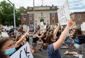 Protesters rally against the death of George Floyd in police custody and police brutality in West Newton.Black Lives Matter rally against police brutality, West Newton, Massachusetts, USA - 04 Jun 2020