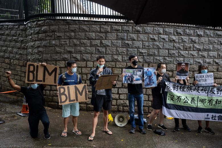 Activists hold 'Black Lives Matter' signs in reaction to the death of George Floyd during a rally outside the U.S. Consulate General in Hong Kong and Macau in Hong Kong, China, 07 June 2020.Activists rally for George Floyd at the US consulate, Hong Kong, China - 07 Jun 2020