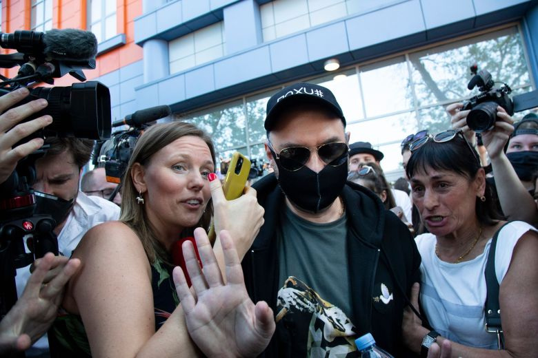 Russian film and theater director Kirill Serebrennikov, wearing a face mask to protect against coronavirus to protect against coronavirus, greets his supporters and colleagues as he leaves the Meshchansky court after hearings in Moscow, Russia, . A Moscow judge has convicted an acclaimed Russian theater director of embezzling state funds and imposed a three-year suspended sentence in a case widely seen as politically motivated. Kirill Serebrennikov and his associates were found guilty of fraud and embezzling 129 million rubles (over $1.8 million) of state funding for a theater projectRussia Theater Director, Moscow, Russian Federation - 26 Jun 2020