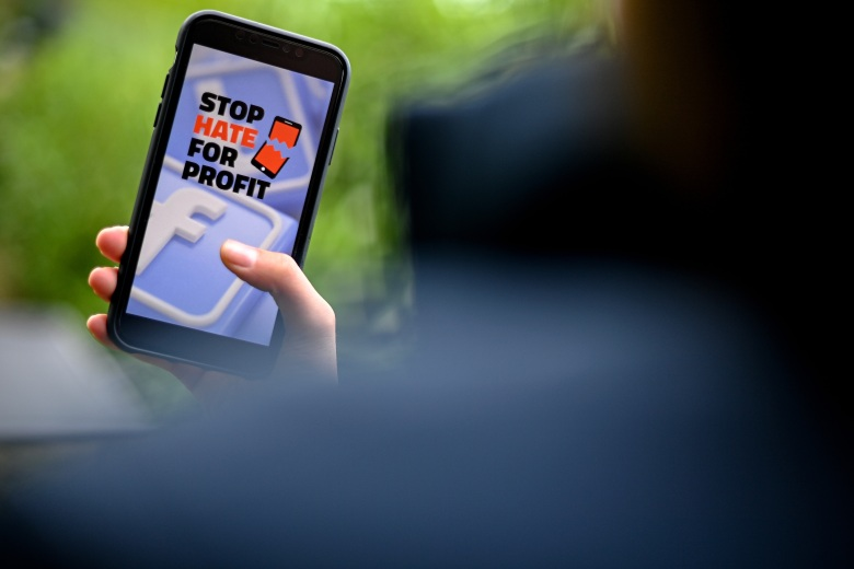 A close-up image shows the slogan of the 'StopHateForProfit' campaign on the organization's website displayed on a smartphone screen in Cologne, Germany, 29 June 2020. Dozens of companies have joined a call for an advertising boycott on Facebook to protest against the American tech giant's handling of hateful comments and derogatory content in its services. The #StopHateForProfit initiative lists more than 160 US companies on its website that have stopped advertising on Facebook in the USA for the time being.Stop Hate For Profit: Advertising boycott against Facebook, Cologne, Germany - 29 Jun 2020