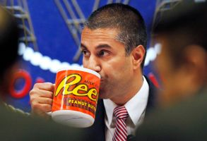 Federal Communications Commission (FCC) Chairman Ajit Pai takes a drink from a mug during an FCC meeting where the FCC will vote on net neutrality, in WashingtonNet Neutrality, Washington, USA - 14 Dec 2017
