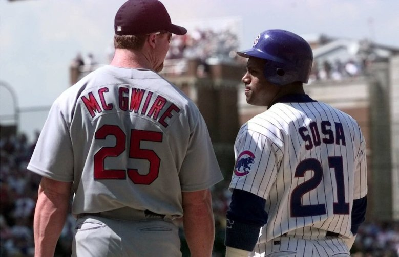 SOSA MCGWIRE Home run sluggers Sammy Sosa (21), of the Chicago Cubs, and St. Louis Cardinals' Mark McGwire (25) talk for a moment at first base after Sosa singled in the second inning, at Wrigley Field in Chicago. This is the first meeting of the two since last year's record-breaking seasonCARDINALS CUBS, CHICAGO, USA