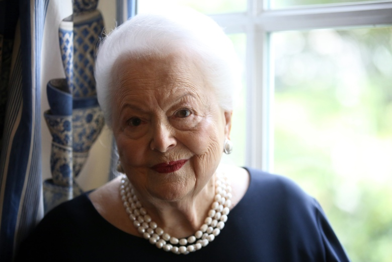 U.S. actress Olivia de Havilland poses during an Associated Press interview, in Paris, Saturday, June 18, 2016. She may be losing her sight and hearing, but the mind of the indomitable actress Olivia de Havilland, who turns 100 Friday, remains as sharp as a tack. (AP Photo/Thibault Camus)