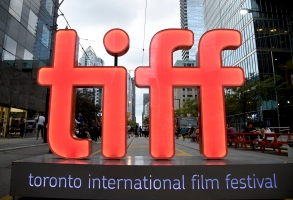 "FILE - In this Thursday, Sept. 6, 2018, file photo, a view of a festival sign appears on Day 1 of the Toronto International Film Festival in Toronto. TIFF organizers announced Tuesday, July 23, 2019, that the upcoming festival will include the premieres of the superhero film ""Joker,"" a Mister Rogers biopic starring Tom Hanks and ""Hustlers,"" a film about strippers scamming Wall Street bankers, with Jennifer Lopez and Cardi B. (Photo by Chris Pizzello/Invision/AP, File)"