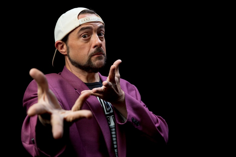 """This Sept. 25, 2019 photo shows Kevin Smith posing during an interview in Los Angeles to promote the film """"Jay and Silent Bob Reboot."""" (Photo by Willy Sanjuan/Invision/AP)"""