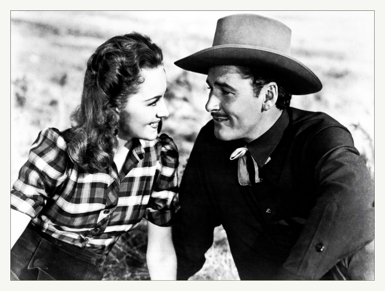 ***FILE PHOTO*** Actress Olivia de Havilland Has Passed Away at 104. 1939 American western film directed by Michael Curtiz and starring Errol Flynn, Olivia de Havilland, and Ann Sheridan. Based on a story by Robert Buckner, the film is about a Texas cattle agent who witnesses the brutal lawlessness of Dodge City, Kansas and takes the job of sheriff to clean the town up. Filmed in early Technicolor, Dodge City was one of the highest-grossing films of the year. This was the 7th of 11 movies that de Havilland and Flynn appeared in together. Credit: Hollywood Photo Archive / MediaPunch /IPX