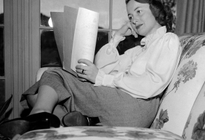 "Film actress Olivia DeHavilland curls up in the living room of her Beverly Hills, Calif. home while reading a script on April 16, 1948. The Oscar winner in the Academy awards will soon start ""The Heiress,"" the current New York stage success which is the first film William Wyler has done since ""The Best Years of our Lives."" DeHavilland is considering another movie to follow that one and then plans to play ""Romeo and Juliet"" on Broadway. (AP Photo/Marcus Goodrich)"