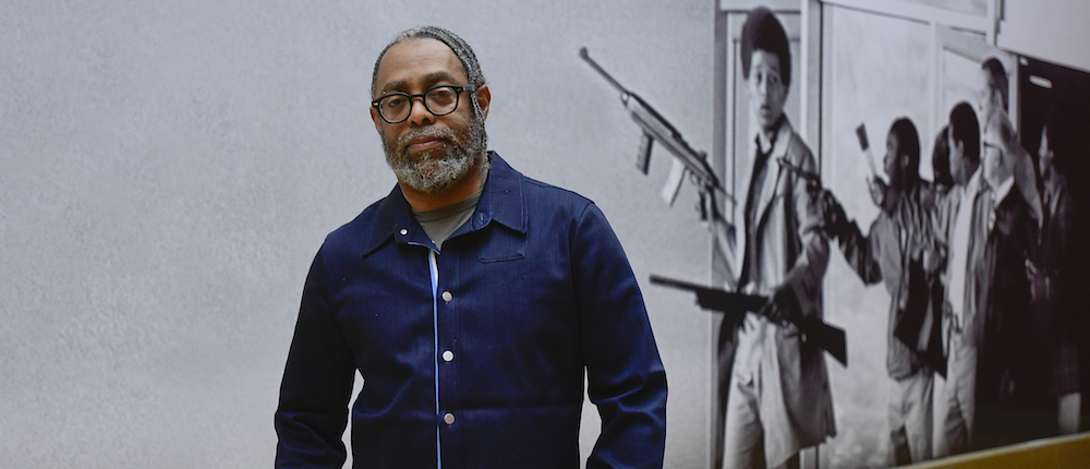 """US artist Arthur Jafa poses in front of a part of the """"A Series of Utterly Improbable, Yet Extraordinary Renditions"""" exhibition by him in the Rudolfinum Gallery in Prague, Czech Republic, on January 16, 2019. Photo/Roman Vondrous (CTK via AP Images)"""