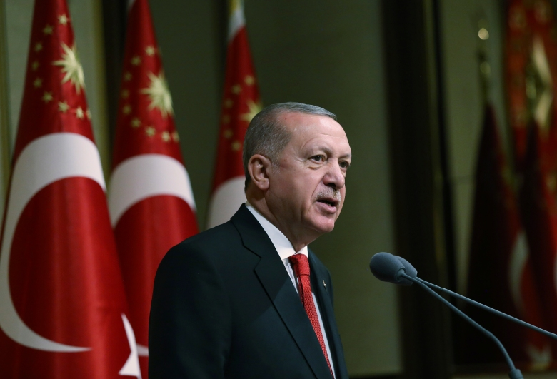 Turkey's President Recep Tayyip Erdogan addresses the family members of coup victims before a dinner at his presidential palace, in Ankara, Turkey, Wednesday, July 15, 2020. Turkey is marking the fourth anniversary of the July 15 failed coup attempt against the government, with prayers and other events remembering its victims. (Turkish Presidency via AP, Pool)