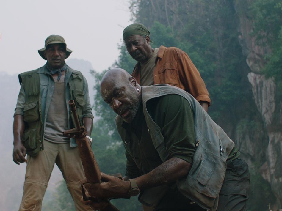 Delroy Lindo (center) stars in<em>Da 5 Bloods</em> as Paul, a Vietnam veteran whose conservative politics are driven by a sense of betrayal