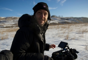 "This photo provided by courtesy of  Twentieth Century Fox shows, cinematographer Emmanuel Lubezki on set for the film, ""The Revenant,"" directed by Alejandro Gonzalez Inarritu. No name is more feverishly celebrated in Hollywood right now than ""Chivo."" That's the nickname of the famed cinematographer Lubezki, whose acrobatic long-takes and luminous natural images of natural light have made him revered -- and may make him a three-peat Oscar winner for ""Gravity,"" ''Birdman"" and now ""The Revenant."" The Oscars will be presented on Feb. 28, 2016, in Los Angeles. (Kimberley French/Twentieth Century Fox via AP)"