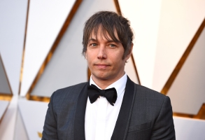 Sean Baker arrives at the Oscars on Sunday, March 4, 2018, at the Dolby Theatre in Los Angeles. (Photo by Jordan Strauss/Invision/AP)