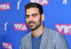 Nyle DiMarco arrives at the MTV Video Music Awards at Radio City Music Hall on Monday, Aug. 20, 2018, in New York. (Photo by Charles Sykes/Invision/AP)