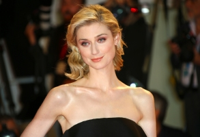 """FILE - Actress Elizabeth Debicki poses for photographers upon arrival at the premiere of the film 'The Burnt Orange Heresy' at the 76th edition of the Venice Film Festival, Venice, Italy, in a Saturday, Sept. 7, 2019 file photo.  Elizabeth Debicki will play the Princess of Wales in seasons five and six of """"The Crown,"""" the Netflix series announced Sunday, Aug. 16, 2020. (Photo by Joel C Ryan/Invision/AP, File)"""