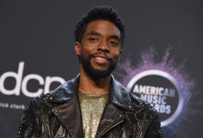 FILE - In this Sunday, Nov. 24, 2019 file photo, Chadwick Boseman poses in the press room at the American Music Awards at the Microsoft Theater in Los Angeles. Actor Chadwick Boseman, who played Black icons Jackie Robinson and James Brown before finding fame as the regal Black Panther in the Marvel cinematic universe, has died of cancer. His representative says Boseman died Friday, Aug. 28, 2020 in Los Angeles after a four-year battle with colon cancer. He was 43. (Photo by Jordan Strauss/Invision/AP, File)