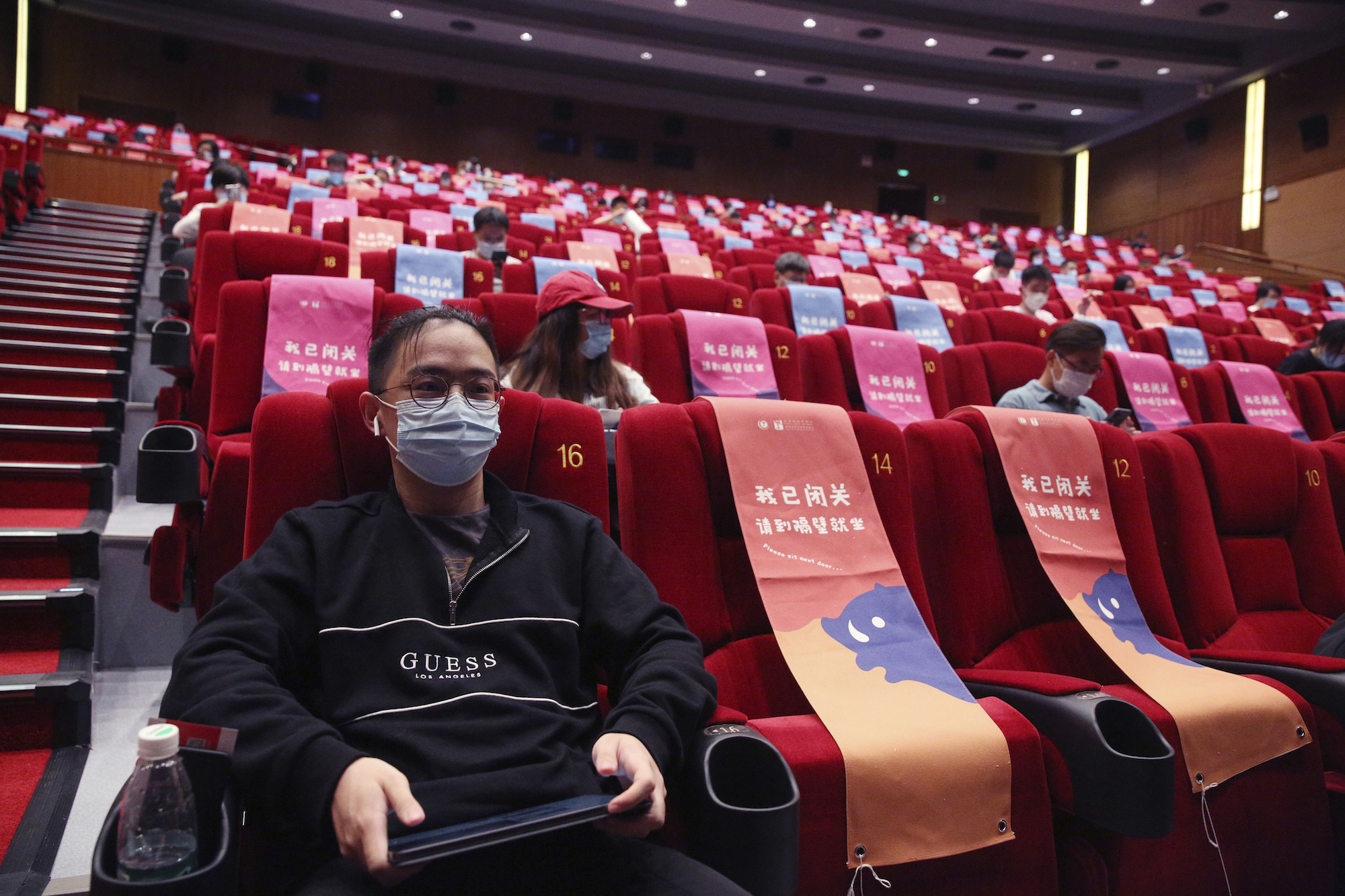 A movie theater restarts in Beijing, China on July 24, 2020, amid continuing worries over the new coronavirus COVID-19. The number of seats is restricted with 30% of the normal number to keep the social distance. ( The Yomiuri Shimbun via AP Images )