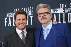 """FILE - In this July 22, 2018 file photo, actor Tom Cruise, left, and director, writer, producer Christopher McQuarrie attend the premiere of """"Mission: Impossible - Fallout"""" in Washington. McQuarrie didn't set out to make the most action-packed """"Mission"""" film in the franchise. It just kind of happened by accident, and it's earning the franchise and Cruise some of the best reviews they've ever gotten. (Photo by Brent N. Clarke/Invision/AP, File)"""