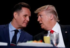President Donald Trump talks with television producer Mark Burnett during the National Prayer Breakfast, Thursday, Feb. 2, 2017, in Washington. (AP Photo/Evan Vucci)