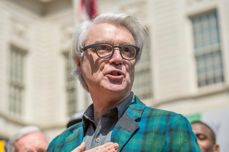 Musician David Byrne is seen at a rally on the steps of City Hall held to denounce cuts to funding for the National Endowment for the Arts and National Endowment for the Humanities contained in the current proposed Federal Budget platform which would adversely impact the NYC cultural programming; in New York, NY, USA on April 3, 2017. (Photo by Albin Lohr-Jones) *** Please Use Credit from Credit Field ***(Sipa via AP Images)