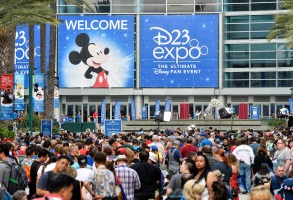 A crowd of people wait to enter the D23 Expo as crews do interviews outside the Anaheim Convention Center in Anaheim, Calif., on Friday, July 14, 2017. (Jeff Gritchen/The Orange County Register via AP)