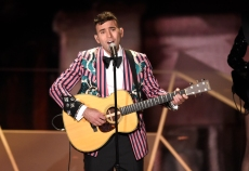 "Sufjan Stevens performs ""Mystery of Love"" from the film ""Call Me By Your Name"" at the Oscars on Sunday, March 4, 2018, at the Dolby Theatre in Los Angeles. (Photo by Chris Pizzello/Invision/AP)"