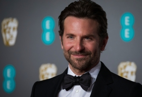 Bradley Cooper poses for photographers upon arrival at the BAFTA awards in London, Sunday, Feb. 10, 2019. (Photo by Vianney Le Caer/Invision/AP)