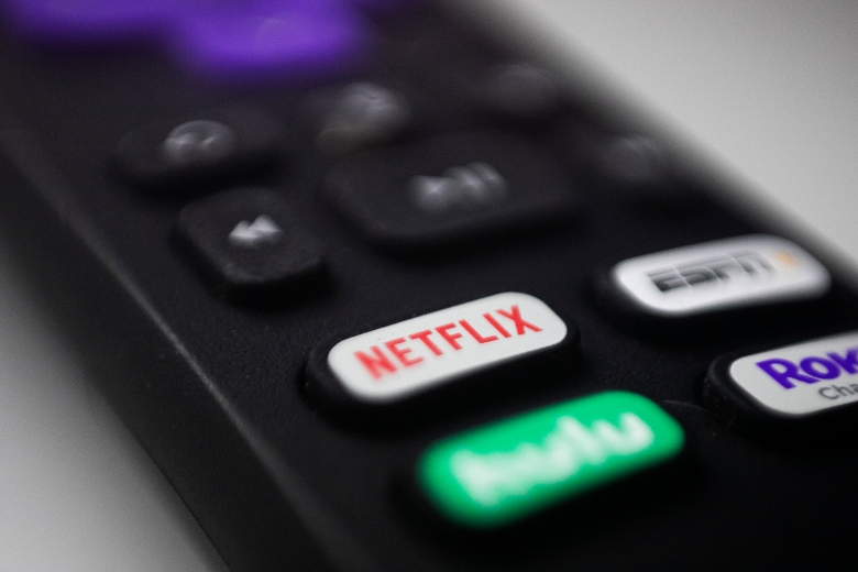 This Aug. 13, 2020, photo shows logos for Netflix, Hulu, ESPN and Roku on a remote control in Portland, Ore. (AP Photo/Jenny Kane)