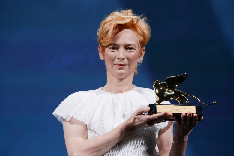 Actress Tilda Swinton holds the Golden Lion for Lifetime Achievement during the opening ceremony of the 77th edition of the Venice Film Festival in Venice, Italy, Wednesday, Sept. 2, 2020. (AP Photo/Domenico Stinellis)