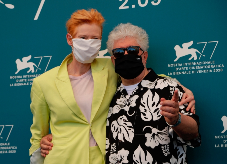 Director Pedro Almodovar and actress Tilda Swinton pose during the photo call for the movie 'The human voice' during the 77th edition of the Venice Film Festival at the Venice Lido, Italy, Thursday, Sep. 3, 2020. The Venice Film Festival goes from Sept. 2 through Sept. 12. Italy was among the countries hardest hit by the coronavirus pandemic, and the festival will serve as a celebration of its re-opening and a sign that the film world, largely on pause since March, is coming back as well. (AP Photo/Domenico Stinellis)