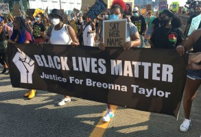 "September 15th 2020: The city of Louisville, Kentucky agrees to pay $12 million to Tamika Palmer (the mother of Breonna Taylor) and family as settlement in compensation for the death of Breonna Taylor who was fatally shot by officers from the Louisville Metro Police Department. - Photo by: zz/STRF/STAR MAX/IPx 2020 8/9/20 A ""Justice For Breonna Taylor"" demonstration and march protesting police brutality and racial inequality on August 9, 2020 in Manhattan, New York City. Demonstrators assembled in Times Square and then marched onto the West Side Highway - blocking vehicular traffic - where they held a sit-in to encourage further action against the Louisville, Kentucky Metro Police Department officers involved in the killing of Breonna Taylor. This protest was in support of the Black Lives Matter movement during the worldwide coronavirus pandemic amid an atmosphere of protests, demonstrations, riots, vandalism and destruction of property in response to the death of George Floyd who died while being arrested by police officers in Minneapolis, Minnesota on May 25th. Cyclists blocked automobile traffic at intersections to allow protesters to march on city streets. Patrons at restaurants providing outdoor dining during the Phase 4 reopening cheered on the protesters. It appeared that a majority of the protesters wore face masks or protective face coverings. (NYC)"