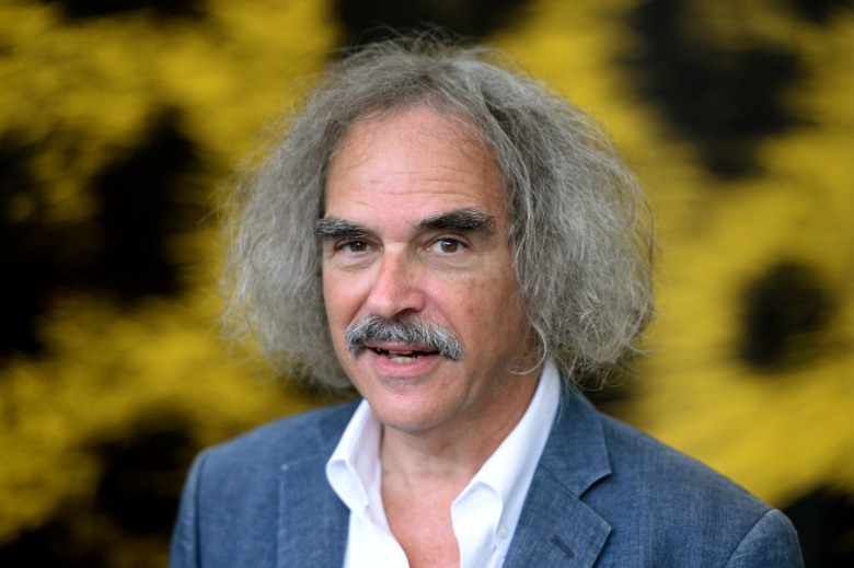 """French Director Eugene Green of the movie """"La Sapienza"""" poses during a photocall at the 67th Locarno International Film Festival, Friday, Aug. 8, 2014, in Locarno, Switzerland. The festival runs from Aug. 6 to 16. (AP Photo/Keystone, Urs Flueeler)"""