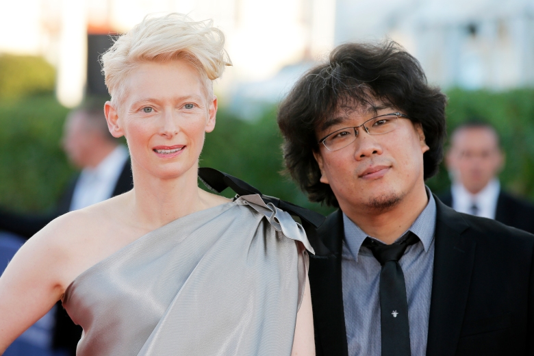 Director Bong Joon-ho, right, and actress Tilda Swinton arrive for the awards ceremony at the 39th American Film Festival, Saturday, Sept 7, 2013, in Deauville, Normandy, western France. (AP Photo/Lionel Cironneau)