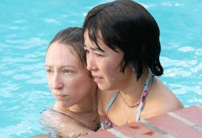 "PEN15 -- ""Pool"" - Episode 201 -- Two days after the dance, Maya and Anna reluctantly go to a lame pool party. A crush unexpectedly shows up, causing them to question their sanity and reputations. Anna Kone (Anna Konkle) and Maya Ishii-Peters (Maya Erskine), shown. (Photo by: Lara Solanki/Hulu)"