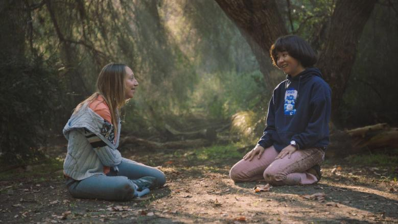 """PEN15 -- """"Vendy Wiccany"""" - Episode 203 -- Anna and Maya discover secret powers within, allowing them to control rocky aspects of their lives through magic. Anna Kone (Anna Konkle), Maya Ishii-Peters (Maya Erskine), shown. (Photo by: Courtesy of Hulu)"""