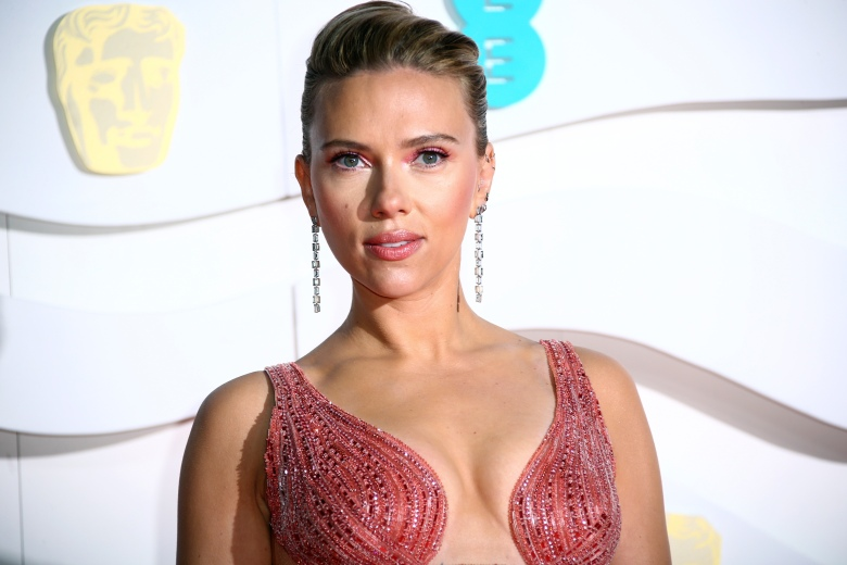 Scarlett Johansson poses for photographers upon arrival at the Bafta Film Awards, in central London, Sunday, Feb. 2 2020. (Photo by Joel C Ryan/Invision/AP)